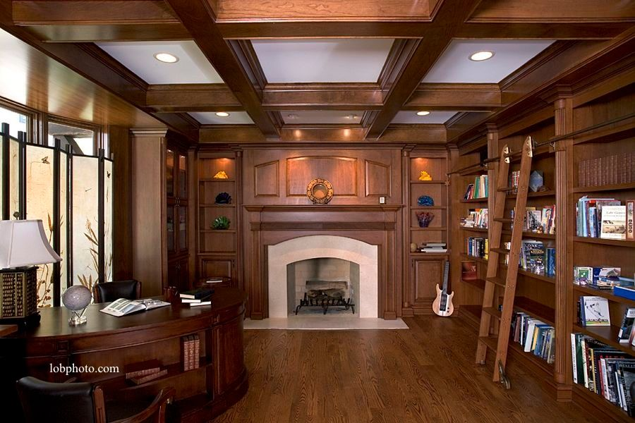Traditional Home Office with Exposed beam, Box ceiling, Laminate floors, can lights, Casement, Standard height, Fireplace