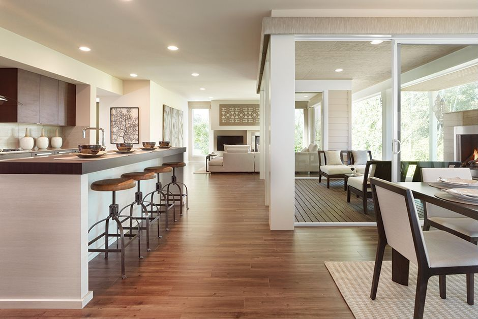Contemporary Great Room with Columns, Standard height, Hardwood floors, Built-in bookshelf, Cement fireplace, picture window