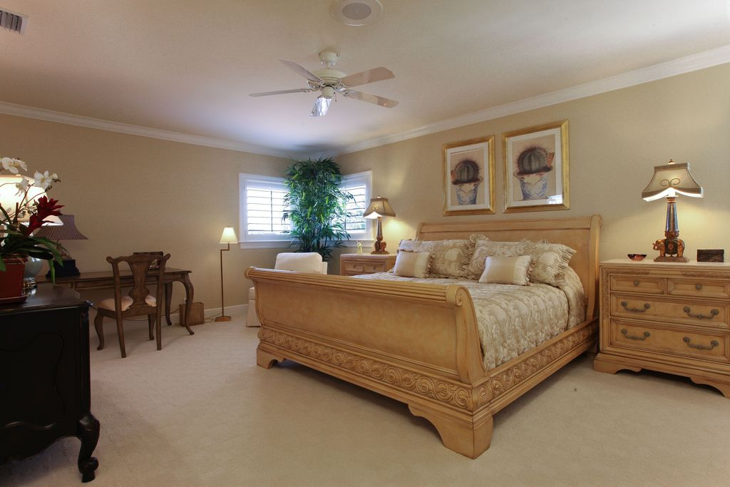 Traditional Master Bedroom with Standard height, Carpet, Crown molding, Casement, Ceiling fan