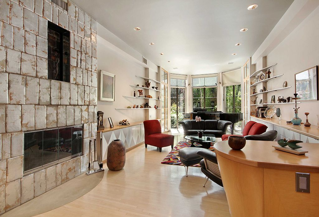 Eclectic Living Room with Built-in bookshelf, Laminate floors, High ceiling, Bay window, insert fireplace, picture window