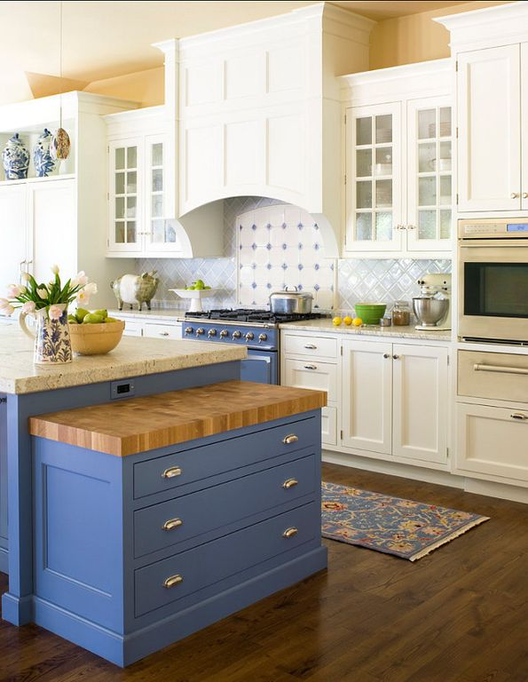 Country Kitchen with Pendant light, Wood counters, Flat panel cabinets, full backsplash, Custom hood, Simple granite counters