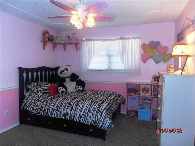 Contemporary Kids Bedroom with no bedroom feature, Built-in bookshelf, Ceiling fan, Carpet, double-hung window, Chair rail