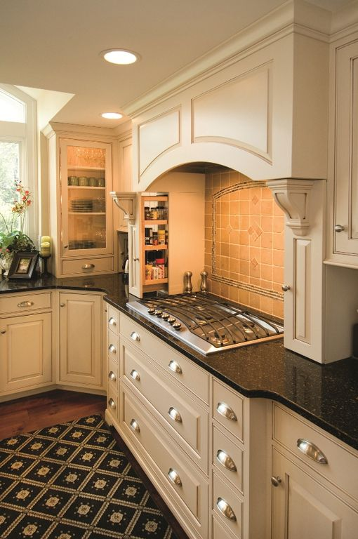 Traditional Kitchen with can lights, Raised panel, Bedrosians Crema Viejo Travertine 4x4, full backsplash, Standard height
