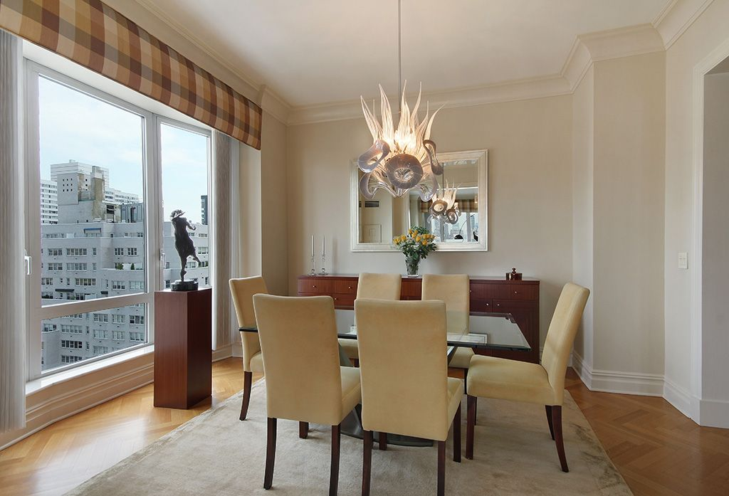 Modern Dining Room with Standard height, picture window, Hardwood floors, Casement, Chandelier, Crown molding