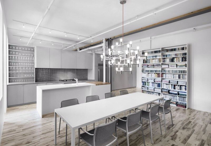 Contemporary Dining Room with Hardwood floors, Built-in bookshelf, Chandelier, Standard height