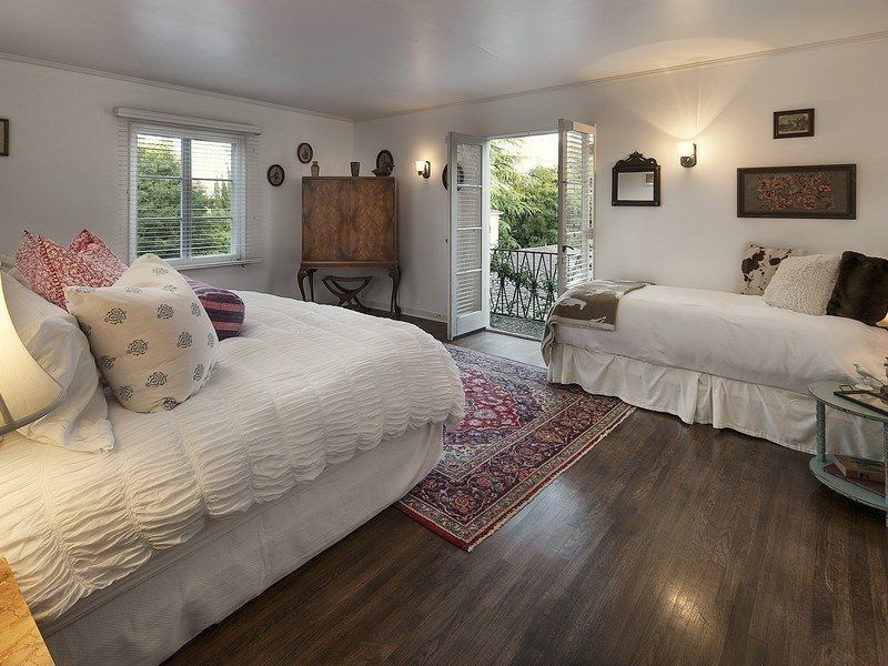 Traditional Guest Bedroom with Crown molding, Paint, Laminate floors, Louvered door, Wall sconce, Standard height, Overstock
