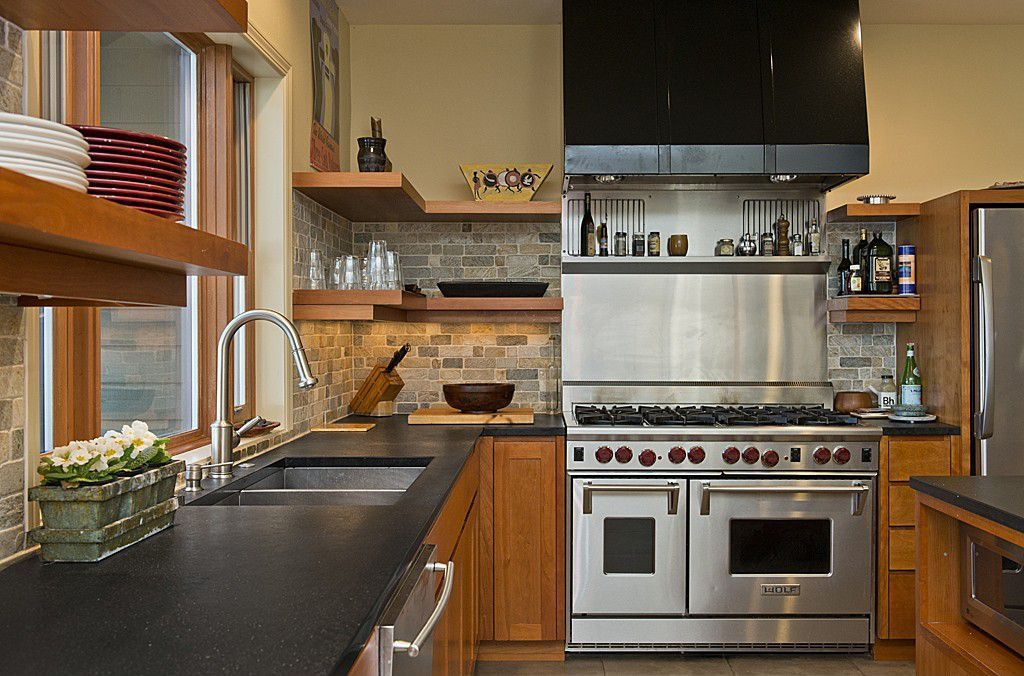Craftsman Kitchen with limestone tile floors, Stainless Steel, Built In Refrigerator, Multiple Sinks, Slate counters
