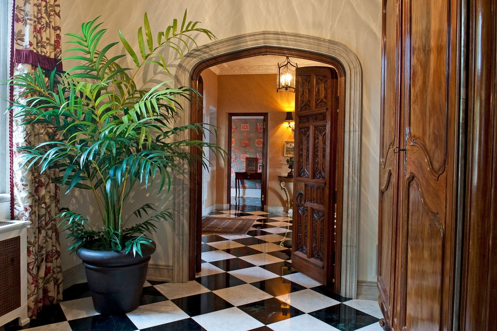 Traditional Entryway with stone tile floors, specialty window, High ceiling, simple marble tile floors, six panel door