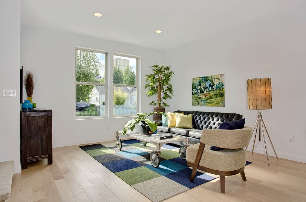 Contemporary Living Room with Hardwood floors, Standard height, double-hung window, can lights