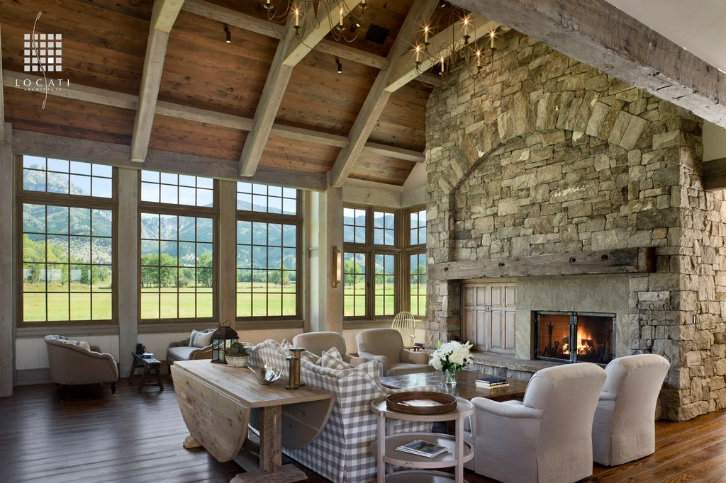 Rustic Great Room with Wall sconce, picture window, Fireplace, Cathedral ceiling, Chandelier, flush light, Hardwood floors