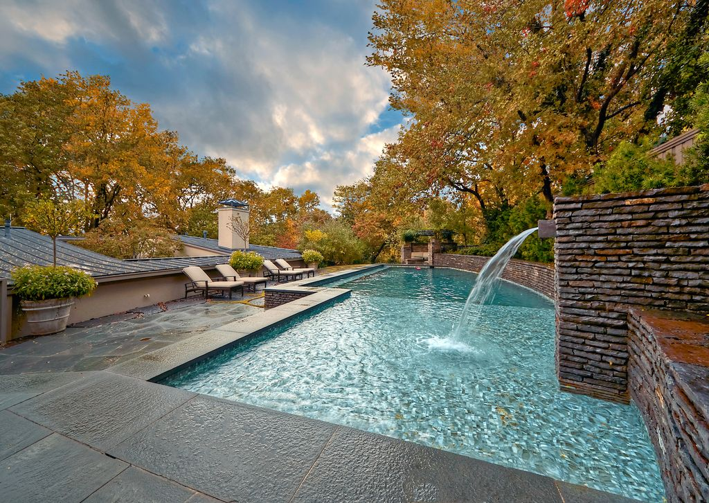 Contemporary Swimming Pool with Pathway, exterior stone floors, Other Pool Type, Fountain, Fence