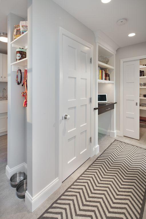 Traditional Mud Room with six panel door, can lights, Built-in bookshelf, Standard height, Concrete floors