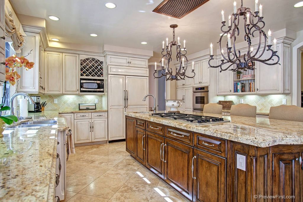 Traditional Kitchen with large ceramic tile floors, Simple granite counters, Stone Tile, Built In Panel Ready Refrigerator