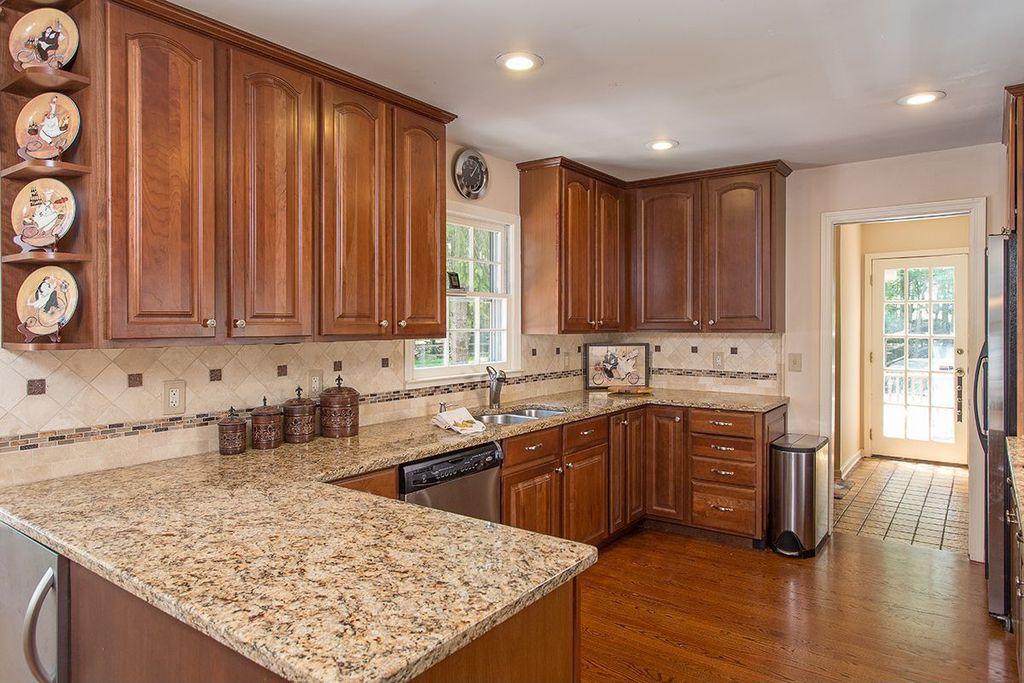 Traditional Kitchen with Limestone Tile, Marble.com Santa Cecilia Granite, Paint 1, full backsplash, Simple granite counters