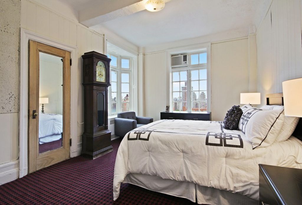 Contemporary Guest Bedroom with Bay window, Exposed beam, Carpet, Wainscotting, flush light, French doors