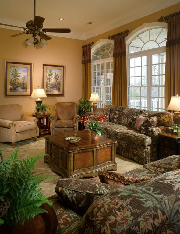 Traditional Living Room with High ceiling, Ceiling fan, can lights, Carpet, Paint, double-hung window