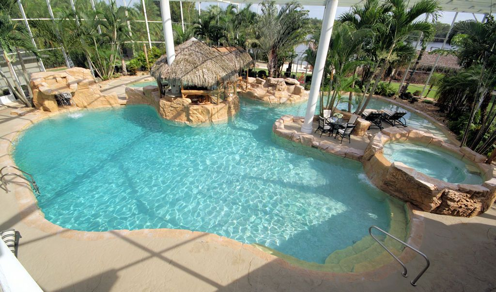 Tropical Swimming Pool with exterior stone floors, Fence, Other Pool Type, Fountain