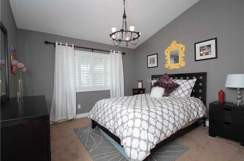 Contemporary Guest Bedroom with Chandelier, Standard height, Carpet, Casement