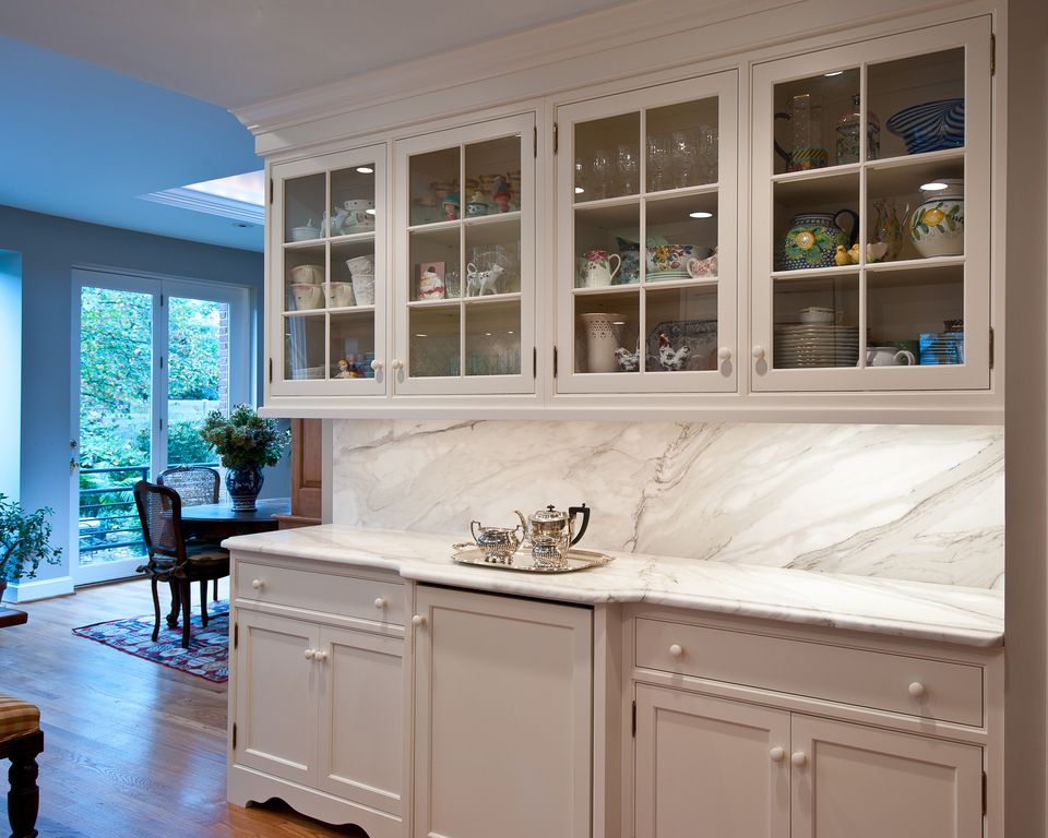 Traditional Kitchen with Skylight, specialty door, can lights, Complex Marble, full backsplash, Glass panel, Standard height