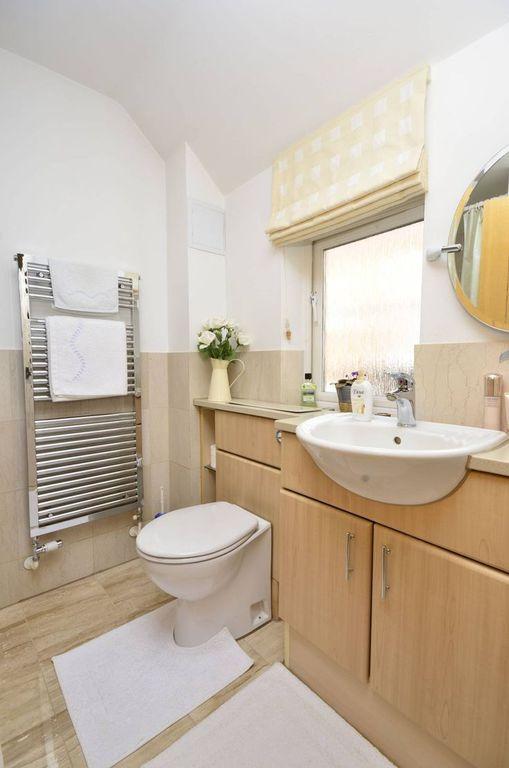 Modern Full Bathroom with Farmhouse sink, full backsplash, European Cabinets, Flush, stone tile floors, Towel warmer