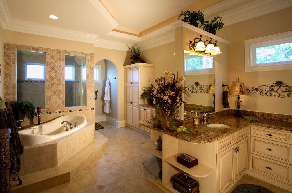 Traditional Master Bathroom with Bathtub, Complex Granite, Undermount sink, drop in bathtub, Standard height, Shower, Flush