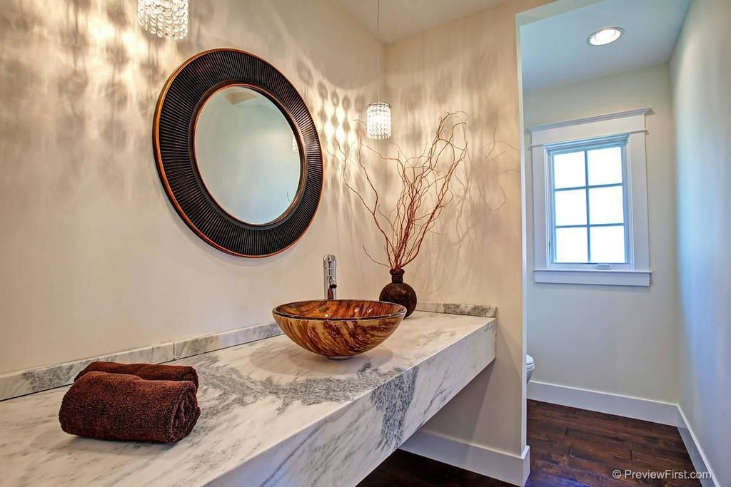 Contemporary Powder Room with Hardwood floors, can lights, Casement, Pendant light, Complex Marble, Powder room, Vessel sink