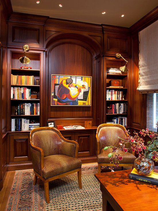 Traditional Home Office with Built-in bookshelf, Standard height, bedroom reading light, can lights, Hardwood floors