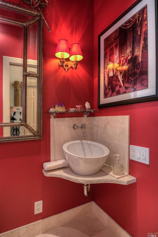 Eclectic Powder Room with Paint, Powder room, Limestone Tile, Standard height, Wall sconce, Vessel sink, six panel door