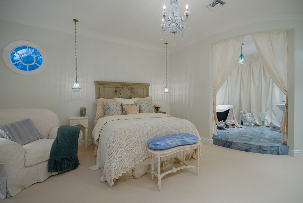 Traditional Guest Bedroom with Built-in bookshelf, Carpet, Crown molding, Pendant light, Chandelier