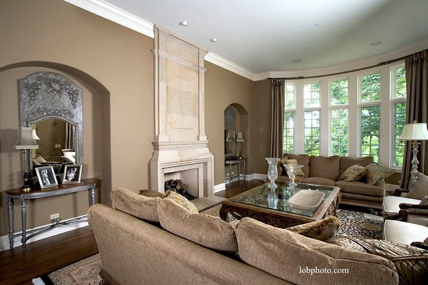 Traditional Living Room with Cement fireplace, Standard height, can lights, Fireplace, Casement, Crown molding