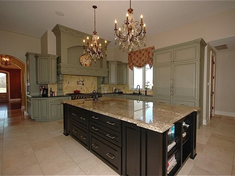 Traditional Kitchen with Undermount sink, Custom hood, L-shaped, Chandelier, Soapstone counters, Simple granite counters