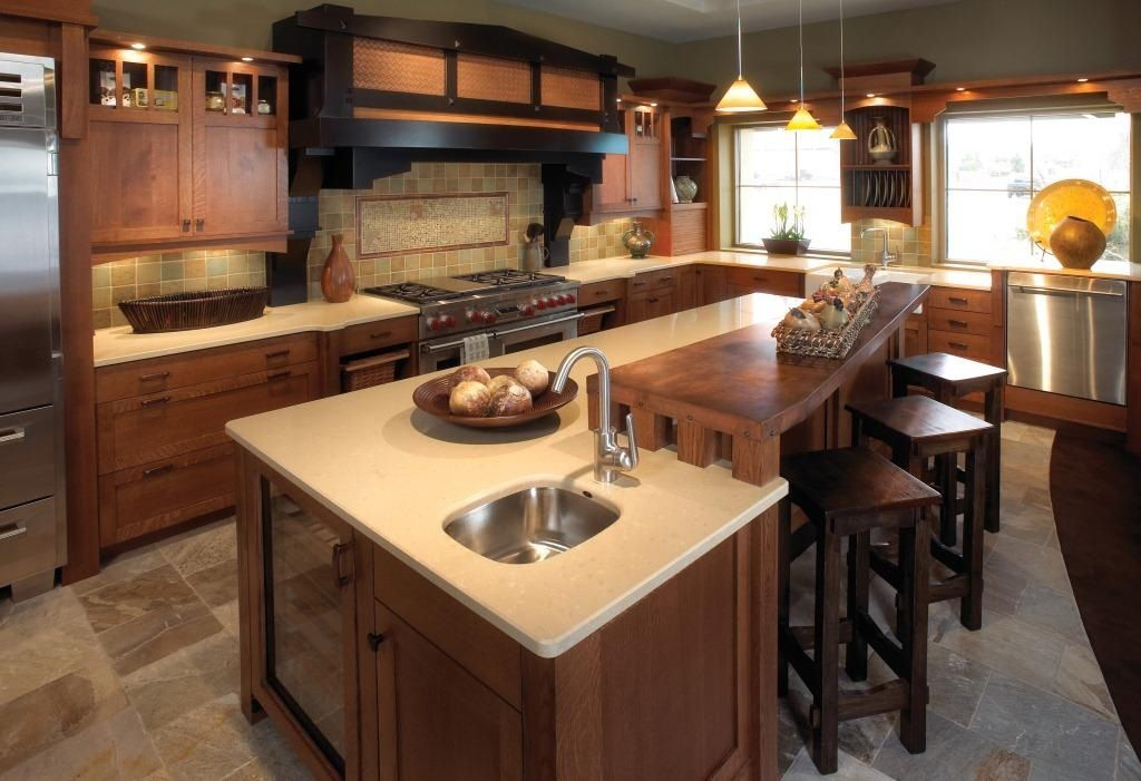 """Craftsman Kitchen with Wine refrigerator, can lights, 12"""" x 12"""" slate tile, Glass panel, stone tile floors, Kitchen island"""