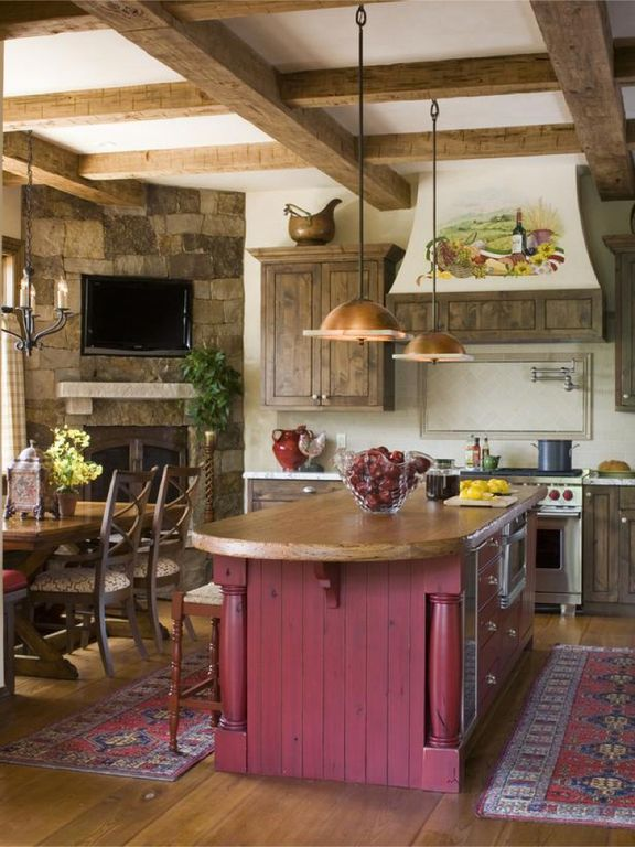 Country Kitchen with Stone Tile, Custom hood, Simple granite counters, Pendant light, gas range, Stacked stone wall, One-wall