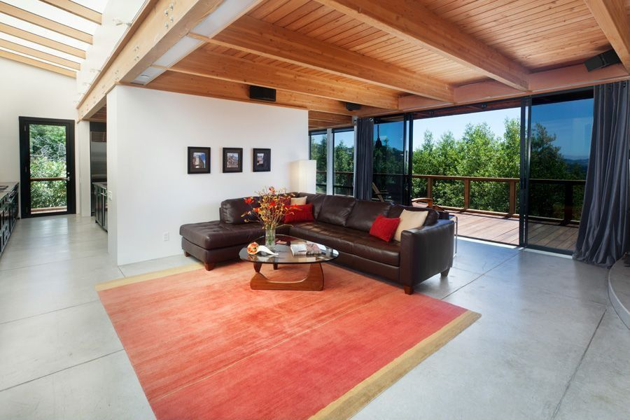 Contemporary Living Room with Standard height, sliding glass door, Concrete tile , Exposed beam