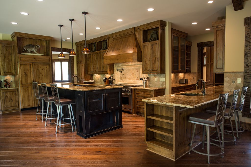 Country Kitchen with Flat panel cabinets, Breakfast bar, Casement, Complex granite counters, U-shaped, Standard height, Paint