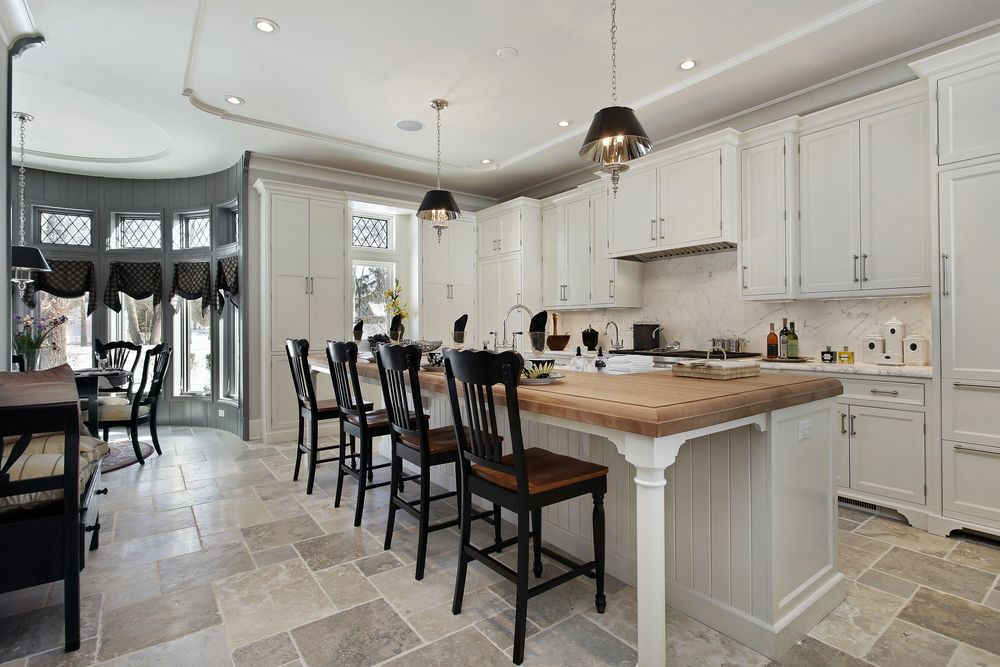 Country Kitchen with Farmhouse sink, electric cooktop, Crown molding, Complex marble counters, full backsplash, Wood counters