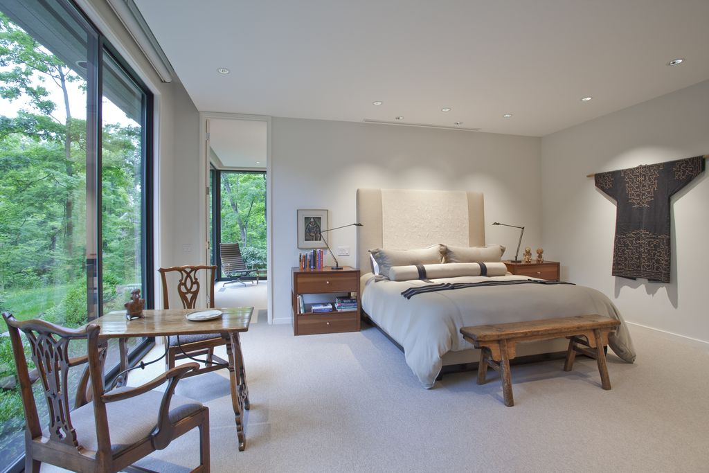 Asian Master Bedroom with can lights, Carpet, Standard height, sliding glass door, Built-in bookshelf, picture window