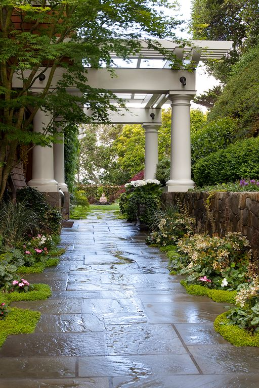 Traditional Landscape/Yard with Fence, Pathway, Trellis, exterior stone floors, Raised beds, Ground cover