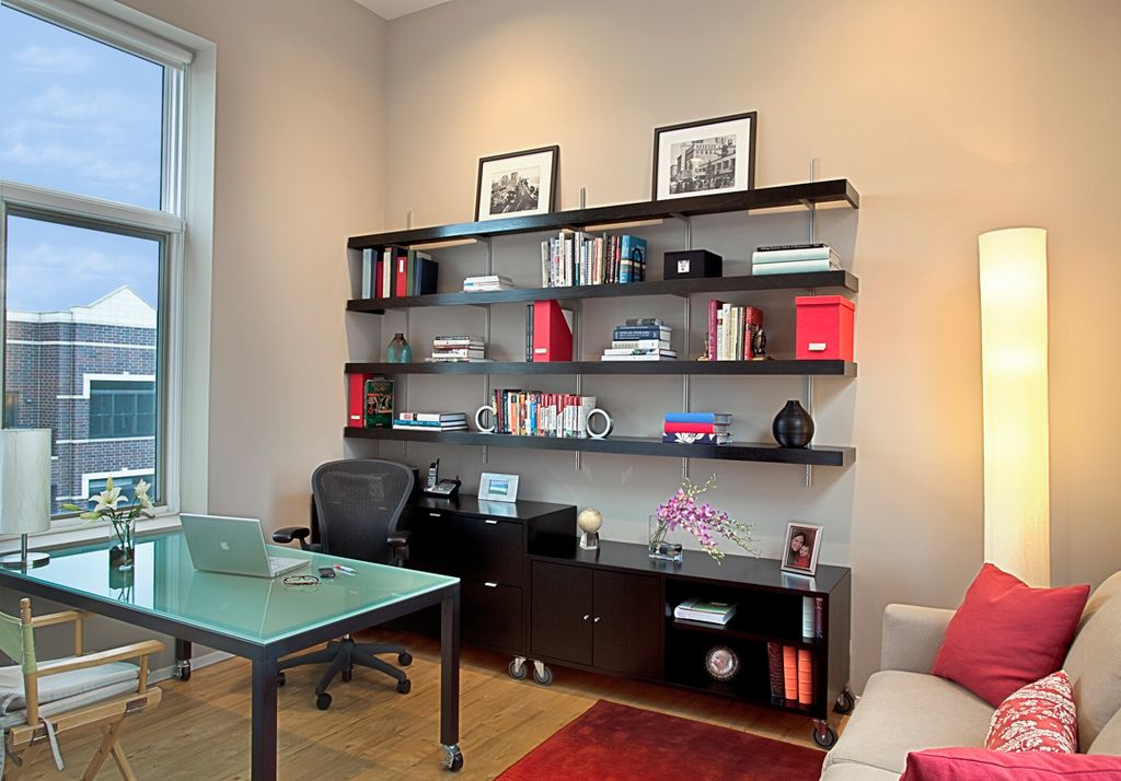 Contemporary Home Office with picture window, Built-in bookshelf, Standard height, Hardwood floors