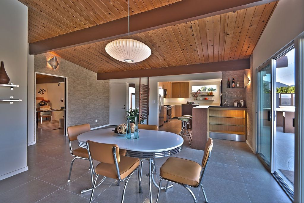 Contemporary Dining Room with Exposed beam, Pendant light, Concrete tile