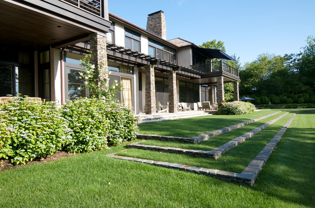 Contemporary Landscape/Yard with sliding glass door, exterior stone floors, Trellis, Pathway, picture window, Transom window