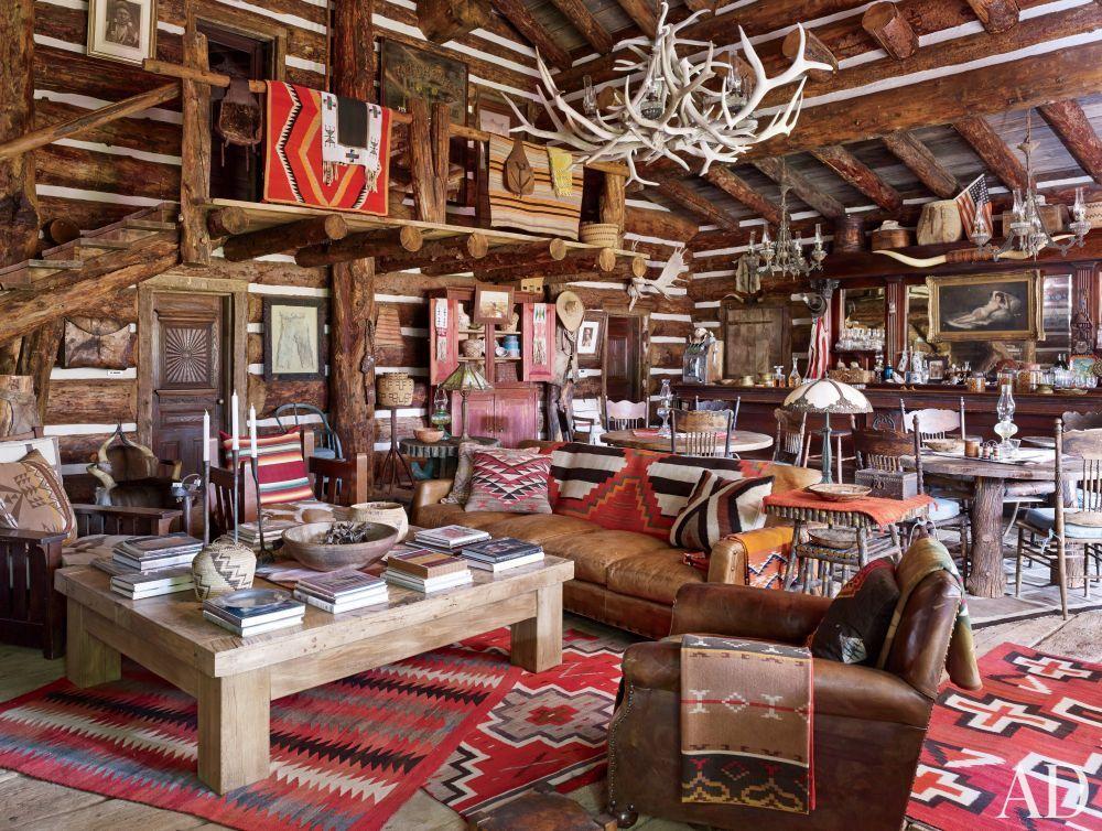 Rustic Great Room with Built-in bookshelf, Columns, High ceiling, Hardwood floors, Loft, specialty door, Chandelier