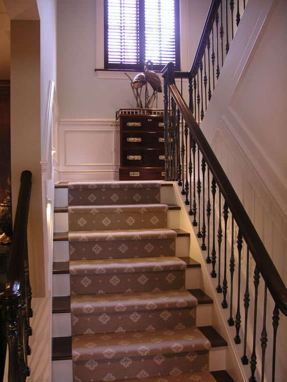 Traditional Staircase with curved staircase, Standard height, Hardwood floors, Casement, Chair rail