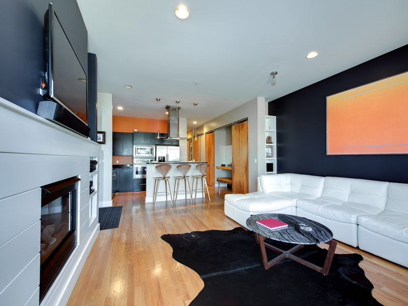 Contemporary Great Room with Standard height, Built-in bookshelf, can lights, Hardwood floors, insert fireplace, Fireplace