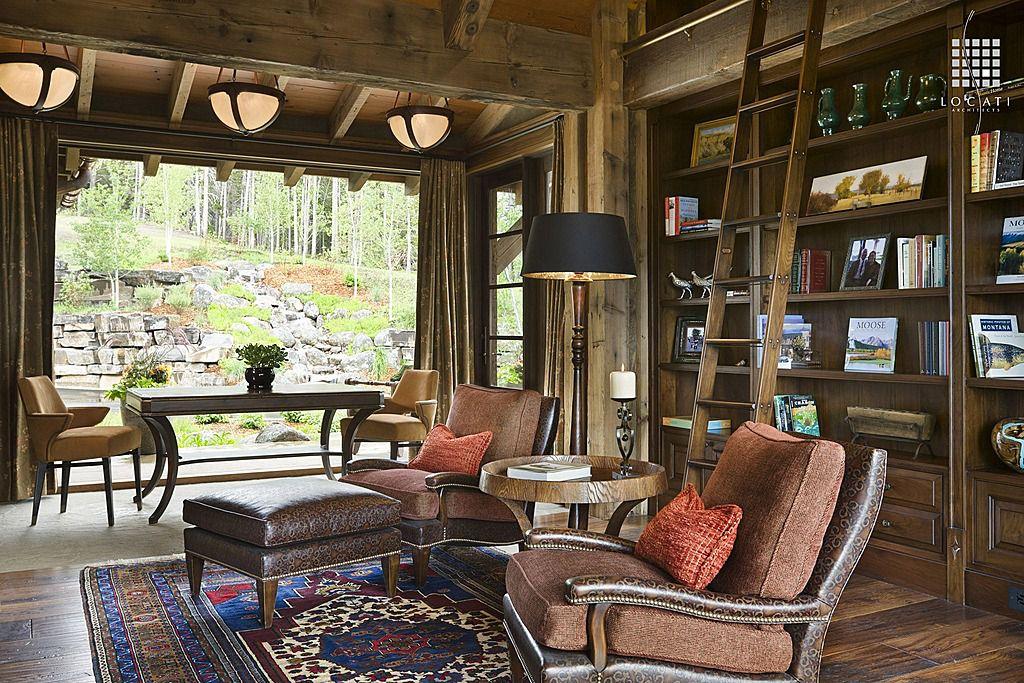 Rustic Living Room with High ceiling, Exposed beam, Built-in bookshelf, French doors, Hardwood floors, Pendant light