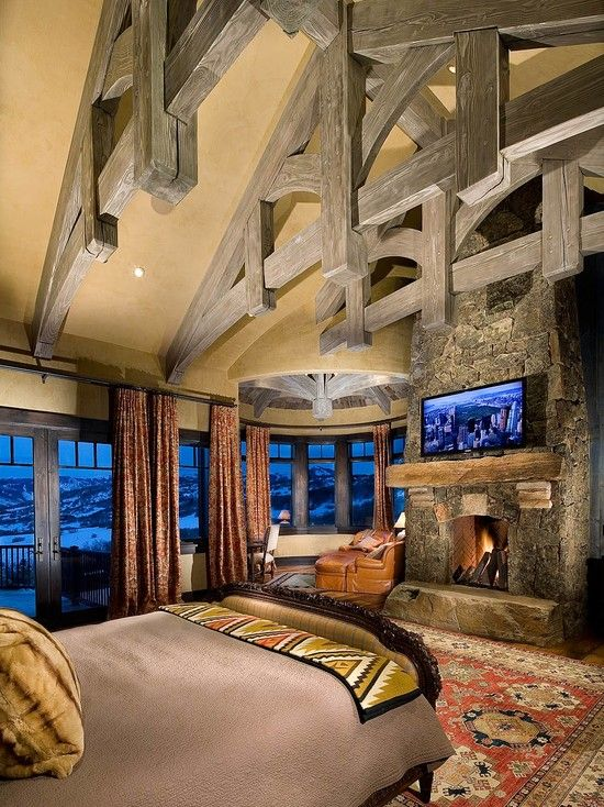 Rustic Master Bedroom with Exposed beam, Oriental rug, Stacked stone wall, French doors, Paint, Laminate floors, can lights