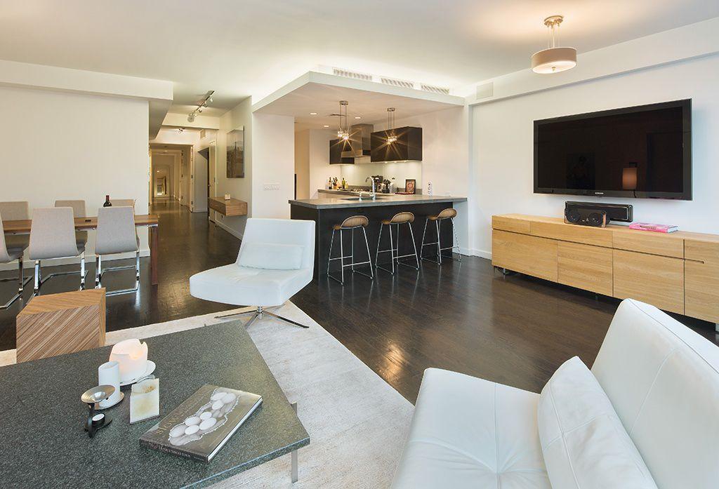 Contemporary Great Room with Built-in bookshelf, Laminate floors, Standard height, flush light, can lights, Pendant light