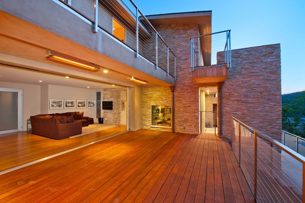 Contemporary Deck with Indoor/outdoor living, Accordion wall, Deck Railing, Built-in shelving, Exterior brick, Paint 1