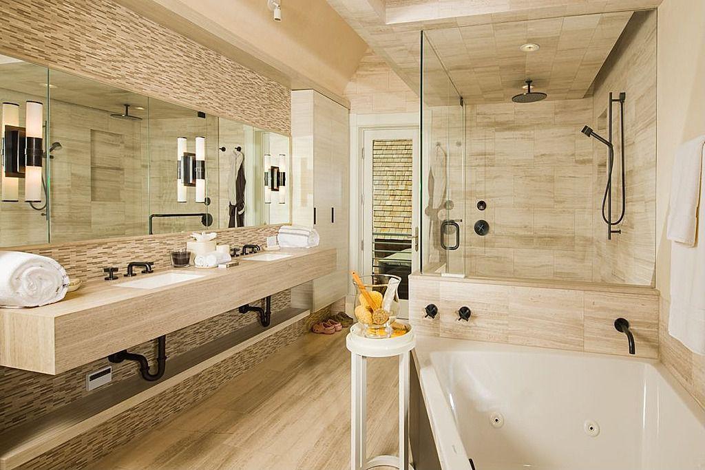 Contemporary Master Bathroom with Rain shower, Ceramic Tile, Bathtub, Master bathroom, full backsplash, Double sink, Skylight