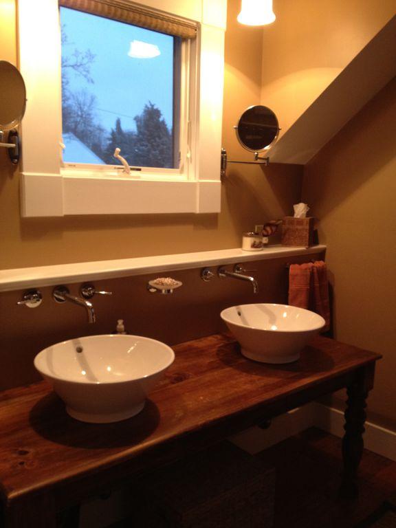 Craftsman Master Bathroom with Double sink, Pendant light, Powder room, Hardwood floors, Vessel sink, Wood counters